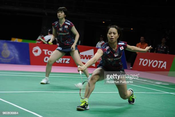 Yuki Fukushima and Sayaka Sato of Japan compete against Rachel Honderich and Kristen Tsai of Canada during Preliminary Round on day two of the BWF...