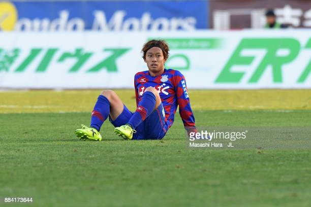 Yuki Horigome of Ventforet Kofu shows dejection after the relegation to the J2 despite his side's 1-0 victory in the J.League J1 match between...