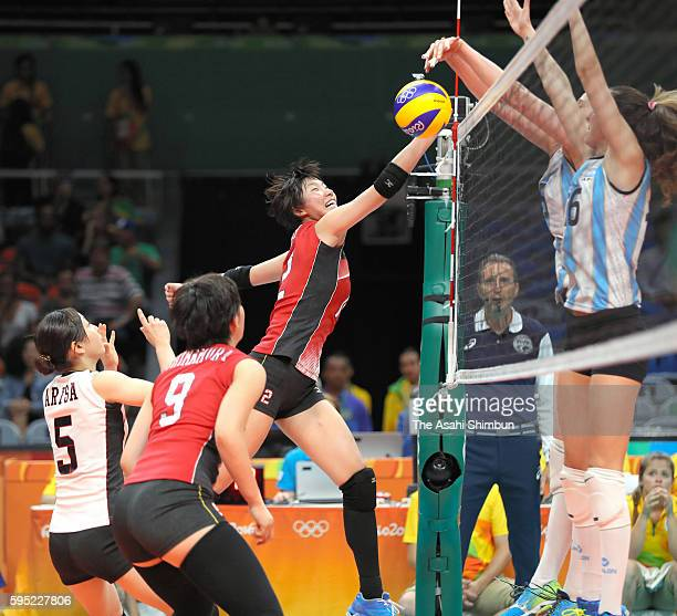 Yuki Ishii of Japan is blocked during the Women's Volleyball Preliminary Group A match between Japan and Argentina on Day 9 of the Rio 2016 Olympics...