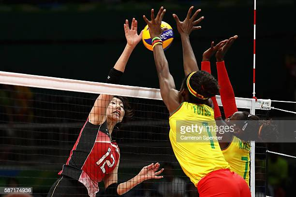 Yuki Ishii of Japan plays a shot during the Women's Preliminary Pool A match between Japan and Cameroon on Day 3 of the Rio 2016 Olympic Games at the...
