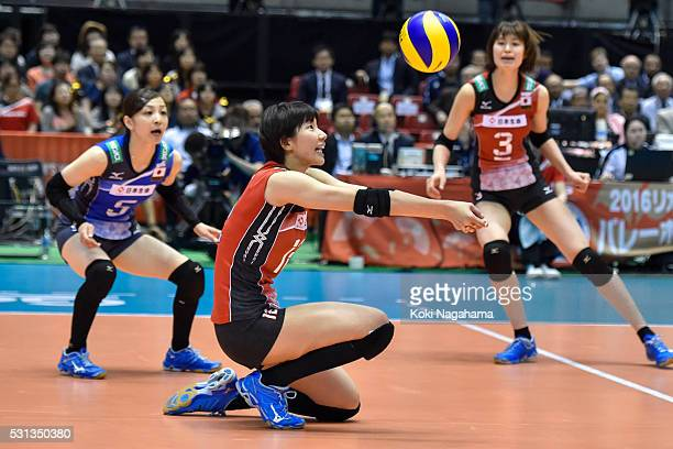 Yuki Ishii of Japan receives the ball during the Women's World Olympic Qualification game between Japan and Peru at Tokyo Metropolitan Gymnasium on...