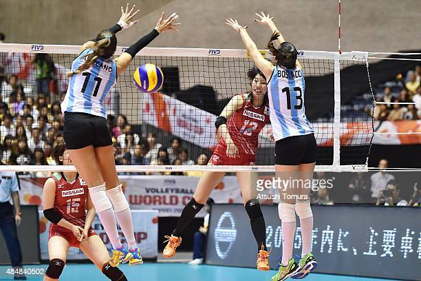 Yuki Ishii of Japan spikes in the match between Argentina and Japan during the FIVB Women's Volleyball World Cup Japan 2015 at Yoyogi National...
