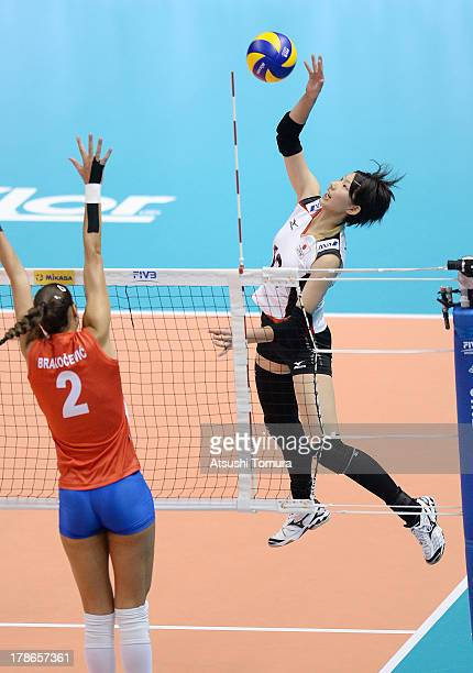 Yuki Ishii of Japan spikes the ball during day three of the FIVB World Grand Prix Sapporo 2013 match between Serbia and Japan at Hokkaido Prefectural...