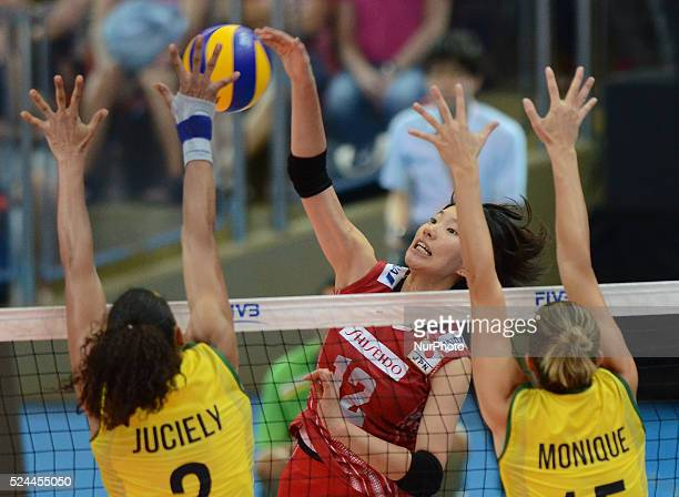 Yuki Ishii of Japan spikes the ball during the FIVB World Grand Prix intercontinental round match against Brazil at Indoor Stadium Huamark in Bangkok...