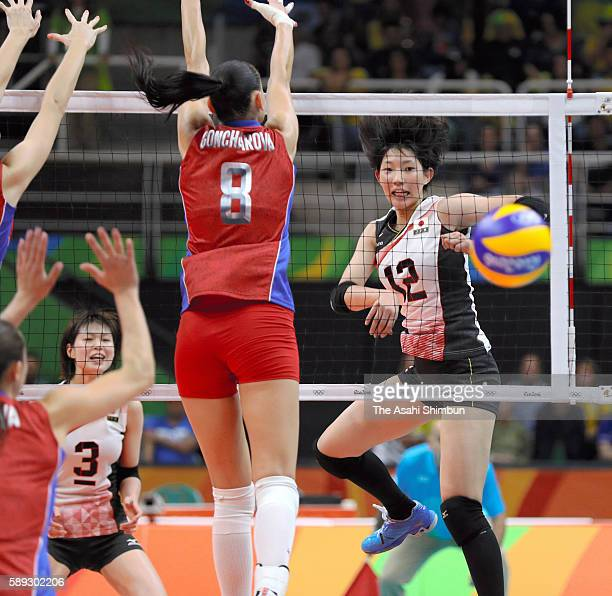 Yuki Ishii of Japan spikes the ball during the Women's preliminary volleyball match between Japan and Russia on Day 7 of the Rio 2016 Olympic Games...
