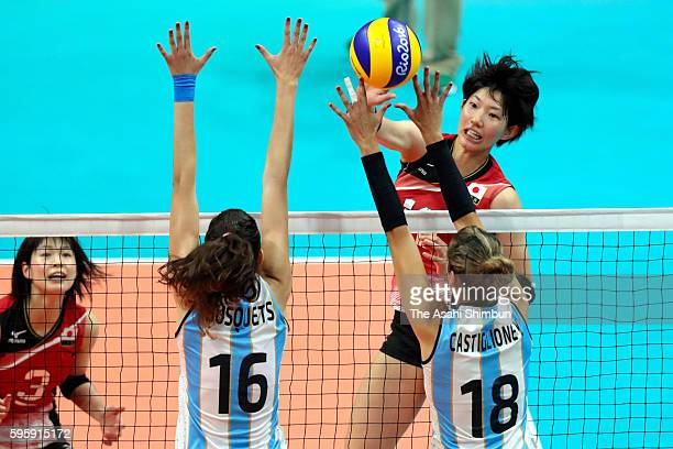 Yuki Ishii of Japan spikes the ball during the Women's Volleyball Preliminary Group A match between Japan and Argentina on Day 9 of the Rio 2016...