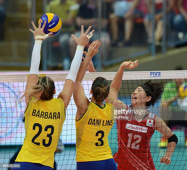 Yuki Ishii of Japan spikes the ball over Brazil players during their FIVB World Grand Prix intercontinental round match at Indoor Stadium Huamark in...