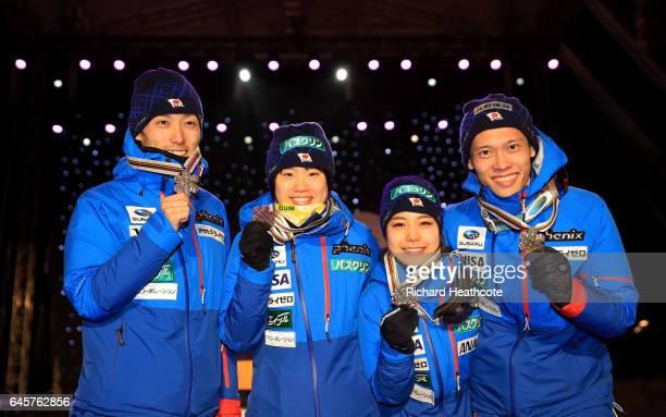 Yuki Ito Daiki ItoTaku Takeuchi and Sara Takanashi of Japan celebrate their bronze medal in the Mixed Team HS100 Normal Hill Ski Jumping during the...