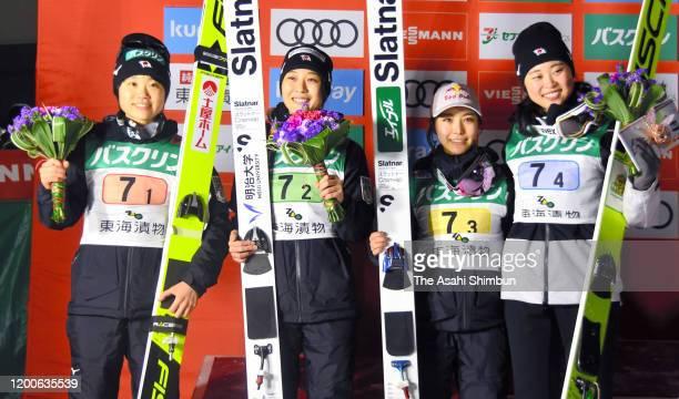 Yuki Ito Nozomi Maruyama Sara Takanashi and Yuka Seto of Japan celebrate their silver medals after the Team competition on day two of the FIS Ski...