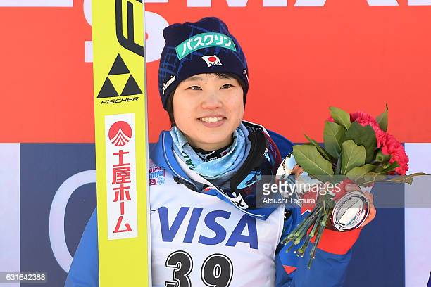 Yuki Ito of Japan smiles on the podium after winning the Normal hill Individual during the FIS Women's Ski Jumping World Cup Sapporo at the...