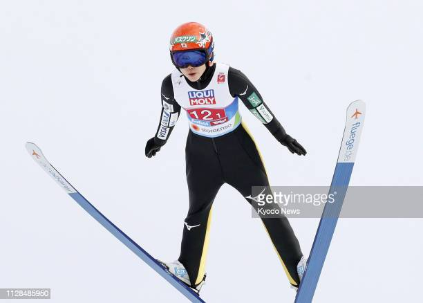 Yuki Ito of Japan soars through the air during her first attempt at the normal hill mixed team event of the Nordic world ski championships in Seefeld...