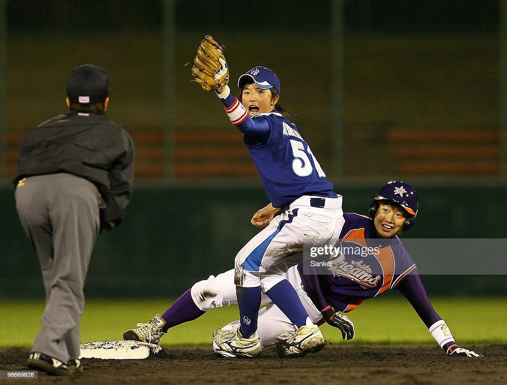 Yuki Kawabata (R) of Kyoto Asto Dreams is tagged out by Miki Atsugase of Hyogo Swing Smileys during the Women's Professional Baseball League opening game between Kyoto Asto Dreams and Hyogo Swing Smileys at Wakasa Stadium Kyoto on April 23, 2010 in Kyoto, Japan. Players are guaranteed two million Japanese yen annual wage,