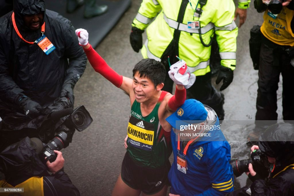 TOPSHOT - Yuki Kawauchi of Japan celebrates after crossing the finish line as the winner of the 2018 and 122nd Boston Marathon for Elite Men's race with a time of 2:15:58. on April 16, 2018 in Boston, Massachusetts. /