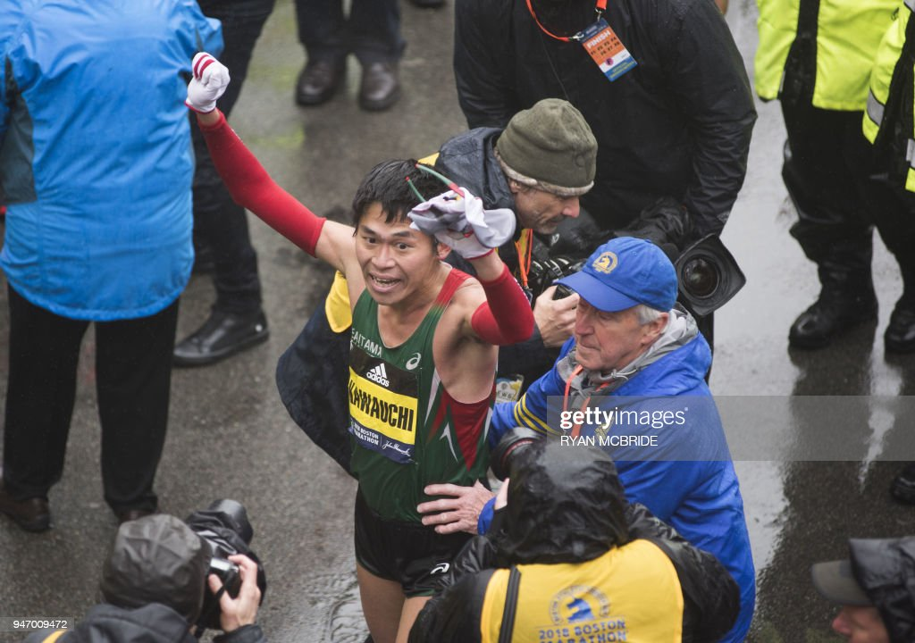 Yuki Kawauchi of Japan celebrates after crossing the finish line as the winner of the 2018 and 122nd Boston Marathon for Elite Men's race with a time of 2:15:58. on April 16, 2018 in Boston, Massachusetts. /