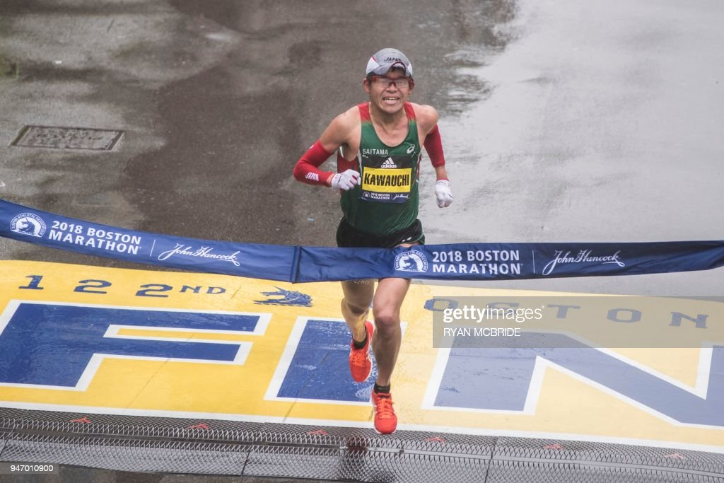Yuki Kawauchi of Japan crosses the finish line as the winner of the 2018 and 122nd Boston Marathon for Elite Men's race with a time of 2:15:58. on April 16, 2018 in Boston, Massachusetts. /