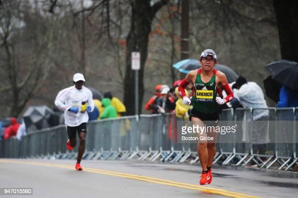 Yuki Kawauchi runs through Heartbreak Hill during the Boston Marathon in Newton Mass April 16 2018