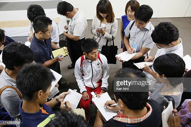 Yuki Kawauchi speaks to the media during the 14th IAAF World Championships Japan team press conference at the National Training Center on July 25...