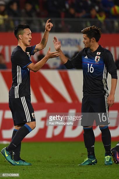 Yuki Kobayashi of Japan celebrates 4th goal with Hotaru Yamaguchi of Japan during the international friendly match between Japan and Oman at Kashima...