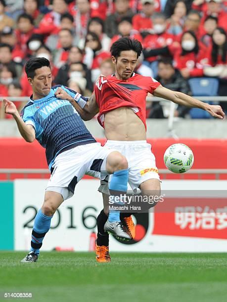 Yuki Kobayashi of Jubilo Iwata and Yuki Abe of Urawa Red Diamonds compete for the ball during the JLeague match between Urawa Red Diamonds and Jubilo...