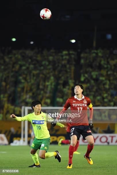 Yuki Kobayashi of Nagoya Grampus and Yamato Machida of JEF United Chiba compete for the ball during the JLeague J1 Promotion PlayOff semi final match...