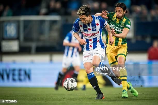 Yuki Kobayashi of sc Heerenveen Abdenasser Nasser El Khayati of ADO Den Haag during the Dutch Eredivisie match between sc Heerenveen and ADO Den Haag...