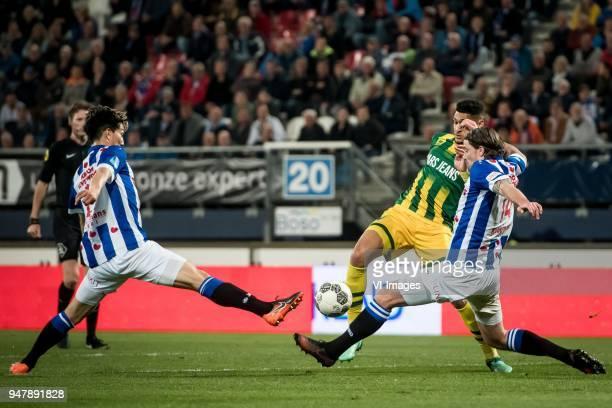 Yuki Kobayashi of sc Heerenveen Bjorn Johnsen of ADO Den Haag Dave Bulthuis of sc Heerenveen during the Dutch Eredivisie match between sc Heerenveen...
