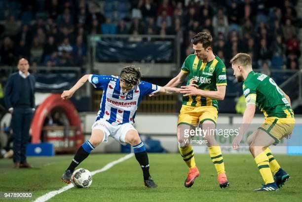 Yuki Kobayashi of sc Heerenveen Erik Valkenburg of ADO Den Haag Aaron Meijers of ADO Den Haag during the Dutch Eredivisie match between sc Heerenveen...