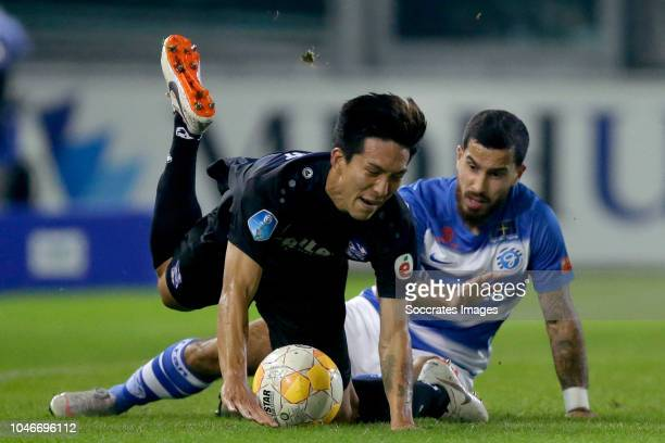 Yuki Kobayashi of SC Heerenveen Jordy Tutuarima of De Graafschap during the Dutch Eredivisie match between De Graafschap v SC Heerenveen at the De...