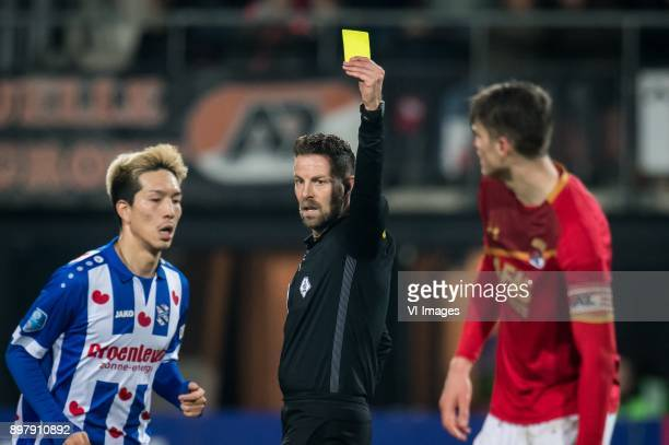 Yuki Kobayashi of sc Heerenveen referee Pol van Boekel Wout Weghorst of AZ during the Dutch Eredivisie match between AZ Alkmaar and sc Heerenveen at...