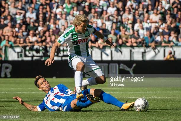Yuki Kobayashi of sc Heerenveen Ritsu Doan of FC Groningen during the Dutch Eredivisie match between FC Groningen and sc Heerenveen at Noordlease...