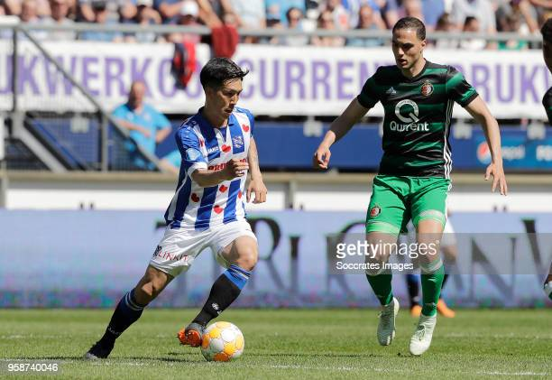 Yuki Kobayashi of SC Heerenveen Sofyan Amrabat of Feyenoord during the Dutch Eredivisie match between SC Heerenveen v Feyenoord at the Abe Lenstra...