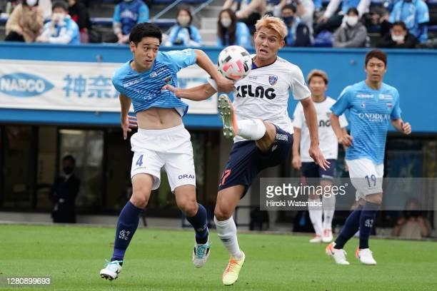 Yuki Kobayashi of Yokohama FC and Kyosuke Tagawa of FC Tokyo compete for the ball during the J.League Meiji Yasuda J1 match between Yokohama FC and...
