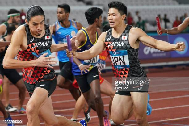 Yuki Koike and Takatoshi Abe of Japan in action the final of the men's 4*400m athletics event during on day twelve of the Asian Games on August 30...