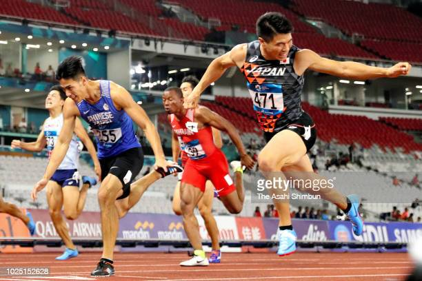 Yuki Koike of Japan and Yang Chunhan of Chinese Taipei cross the finish line to win the Men's 200m at the GBK Main Stadium on day eleven of the Asian...