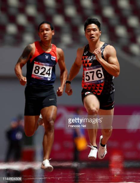 Yuki Koike of Japan competes in the men's 200m heats during day three of the 23rd Asian Athletics Championships at Khalifa International Stadium on...