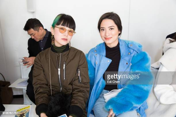 Yuki Matsuda and Nicole Andersson attend the Michael Kors Collection Fall 2018 Runway Show at the Vivian Beaumont Theatre on February 14 2018 in New...