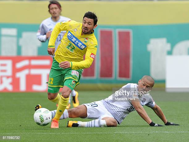 Yuki Matsushita of Thesupa Kusatsu Gunma and Aranda of JEF United Chiba compete for the ball during the JLeague second division match between JEF...