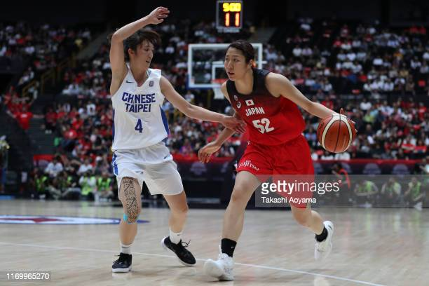 Yuki Miyazawa of Japan drives to the basket against Chia Wen Kuo of Chinese Taipei during the Game One of the women's basketball international game...