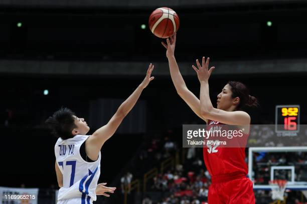 Yuki Miyazawa of Japan shoots against Yu Chin Chu of Chinese Taipei during the Game One of the women's basketball international game between Japan...