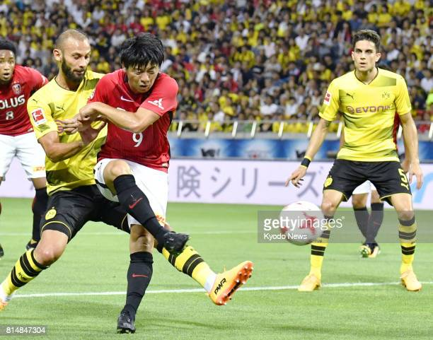 Yuki Moto of Urawa Reds aims to make a shot on goal during the first half of an international friendly against Borussia Dortmund at Saitama Stadium...