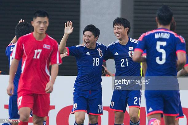 Yuki Muto of Japan celebrates with team mates after scoring his team's first goal during the EAFF East Asian Cup 2015 football match between DPR...