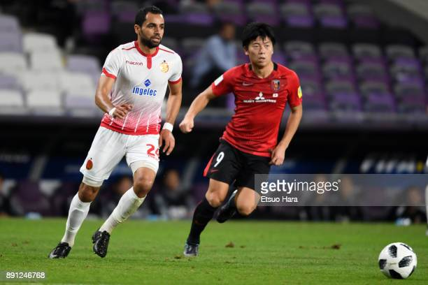 Yuki Muto of Urawa Red Diamonds and Jamal Ait Ben Idir of Wydad Casablanca compete for the ball during the FIFA Club World Cup UAE 2017 Match for 5th...