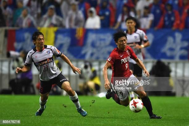Yuki Muto of Urawa Red Diamonds and Shoya Nakajima of FC Tokyo compete for the ball during the JLeague J1 match between Urawa Red Diamonds and FC...