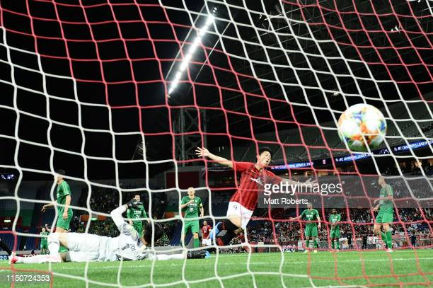 Yuki Muto of Urawa Red Diamonds celebrates scoring a goal during the AFC Champions League Group G match between Urawa Red Diamonds and Beijing Guoan...