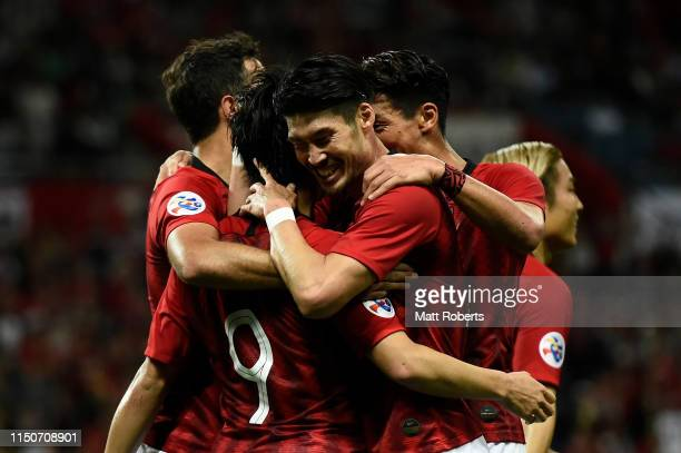 Yuki Muto of Urawa Red Diamonds celebrates scoring a goal with team mates during the AFC Champions League Group G match between Urawa Red Diamonds...