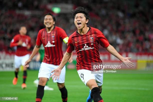 Yuki Muto of Urawa Red Diamonds celebrates scoring his side's second goal during the AFC Champions League Group G match between Urawa Red Diamonds...