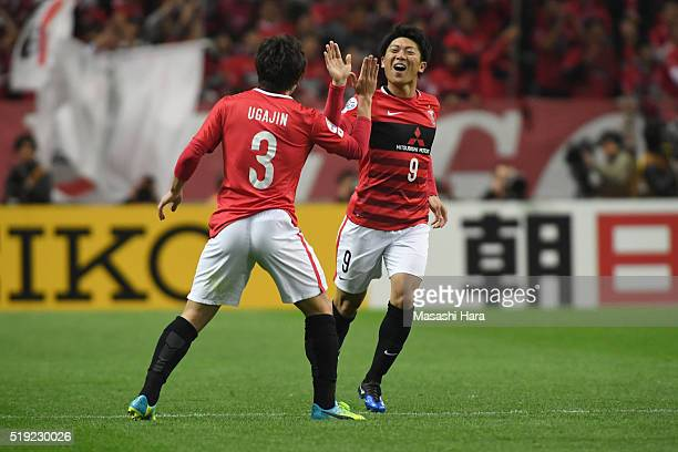Yuki Muto of Urawa Red Diamonds celebrates the first goal during the AFC Champions League Group H match between Urawa Red Diamonds and Guangzhou...