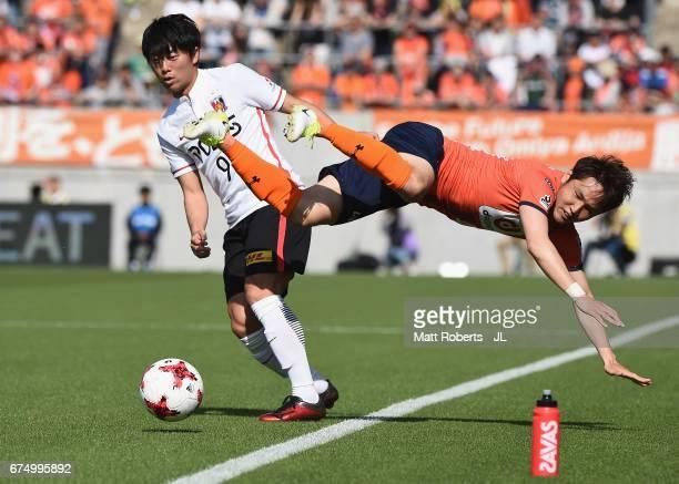 Yuki Muto of Urawa Red Diamonds competes for the ball against Akimi Barada of Omiya Ardija during the J.League J1 match between Omiya Ardija and...