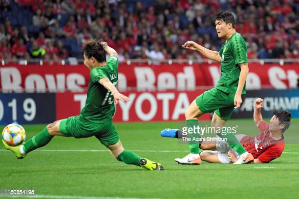 Yuki Muto of Urawa Red Diamonds scores his side's second goal during the AFC Champions League Group G match between Urawa Red Diamonds and Beijing...