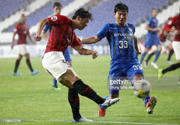 Yuki Muto of Urawa Red Diamonds shoots at goal during the AFC Champions League round of 16 second leg match between Ulsan Hyundai and Urawa Red...